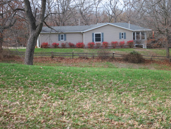 side view of home of Wapello 120 acre listing