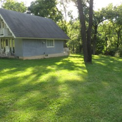 Wapello home on 5 acre side view of home