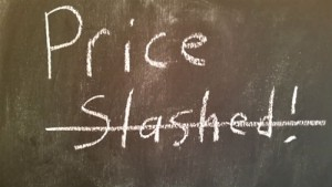 real estate sign that says price is slashed!