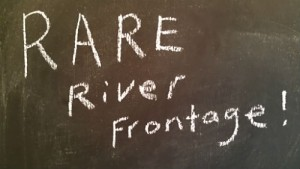 sign that reads rare river frontage.